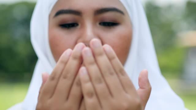 religious muslim woman praying,muslim lifestyle concept. - hijab stock videos & royalty-free footage