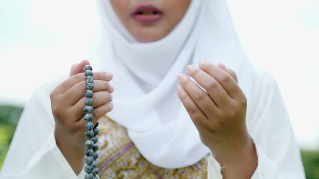 religious muslim woman praying.muslim lifestyle - islam stock videos & royalty-free footage