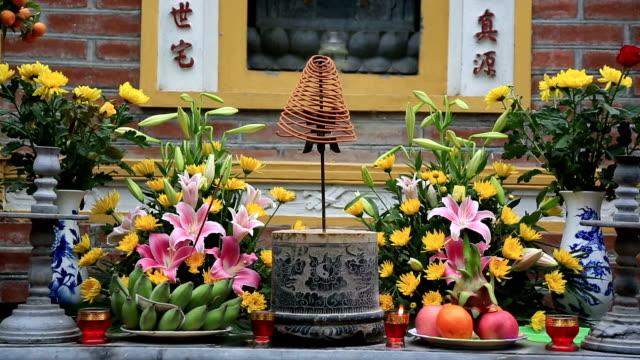 stockvideo's en b-roll-footage met religious offering in a temple, vietnam - vietnam