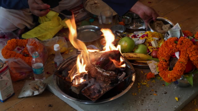 religious offerings called havan and prayers in hinduism during a puja ceremony - ceremony stock videos & royalty-free footage