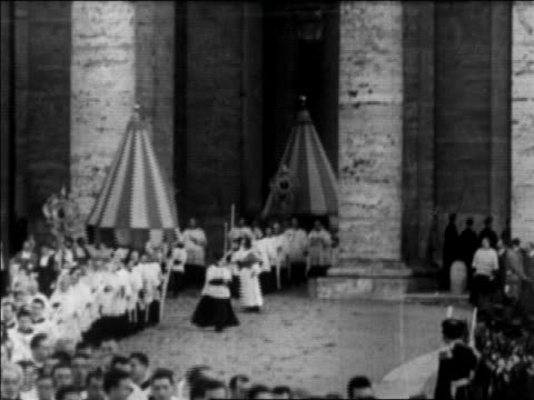 b/w 1929 religious parade exiting from st peter's basilica / vatican city / newsreel - catholicism stock videos and b-roll footage