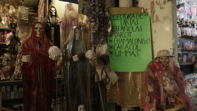 religious santa muerte figurines in mexico - afterlife stock videos and b-roll footage