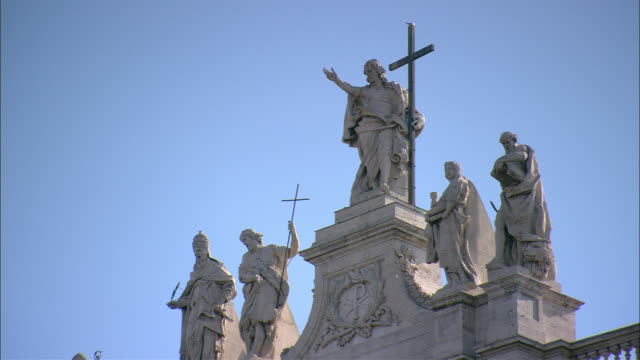 Religious statues cover the roof of St. Peter's Basilica in Vatican City.