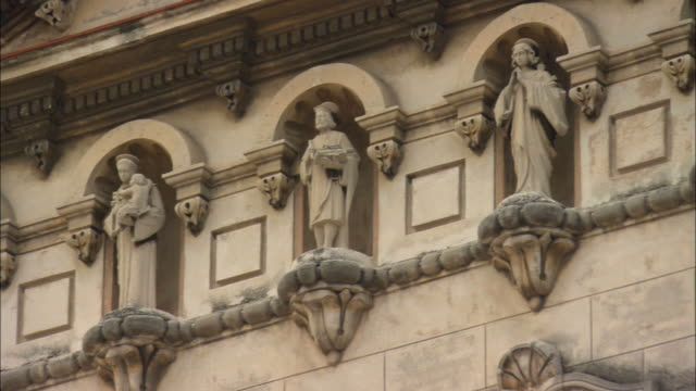 MS, LA, PAN, religious statues on side of building, Havana, Cuba