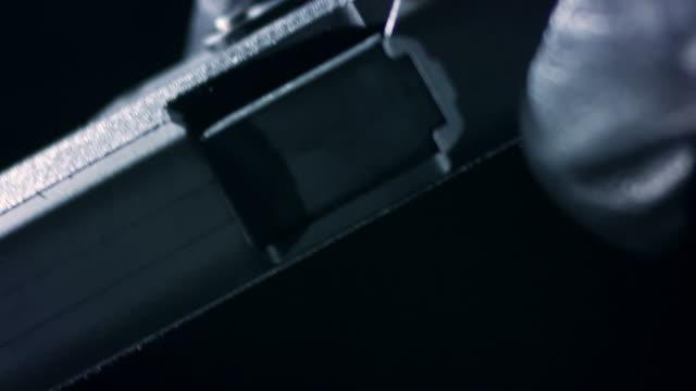 reloading a gun - handgun stock videos & royalty-free footage