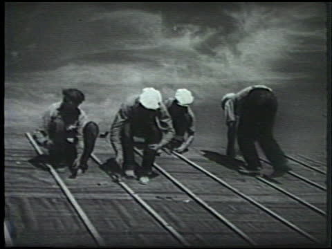 relocation centers under construction. vs completed relocation centers, japanese americans in line entering center, camp. int japanese people dining... - internment of japanese americans stock videos & royalty-free footage