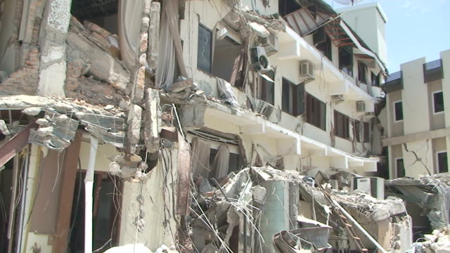remains of 5 star hotel in downtown padang city / audio - indonesia video stock e b–roll