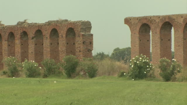 ws pan remains of roman aqueduct in aqueducts park near ciampino airport / rome, italy - ciampino airport video stock e b–roll