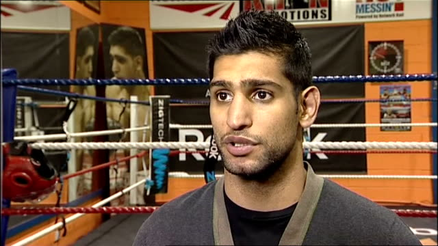 rematch of amir khan v lamont peterson fight ordered england greater manchester bolton amir khan interview sot going to put pressure on them for a... - bolton greater manchester stock videos and b-roll footage