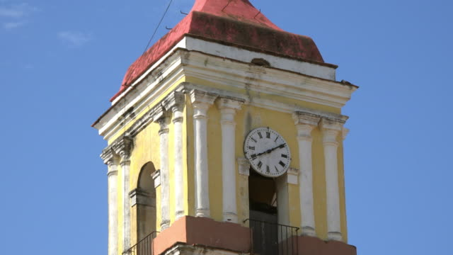 remedios cuba: colonial architecture roman catholic church bell and clock tower  tilt down - bell tower tower stock videos and b-roll footage