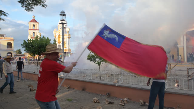 remedios, villa clara, cuba-december 24, 2019: the 'san salvador' district is launching fireworks during the 'greeting' stage in the afternoon. the... - atmosphere filter stock-videos und b-roll-filmmaterial