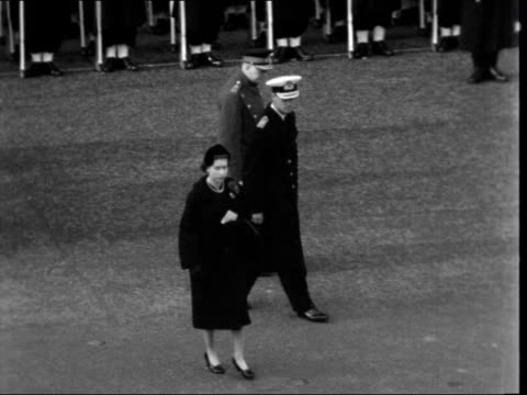 london cenotaph flags on cenotaph pull back to clergy in procession round cenotaph mls harold macmillan hugh gaitskell and other ministers line up... - remembrance day stock videos & royalty-free footage