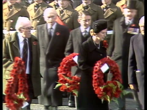 stockvideo's en b-roll-footage met queen leads mourning at cenotaph england london whitehall cenotaph memorial cs flags on cenotaph cs the glorious dead on cenotaph gv crowds and... - politics