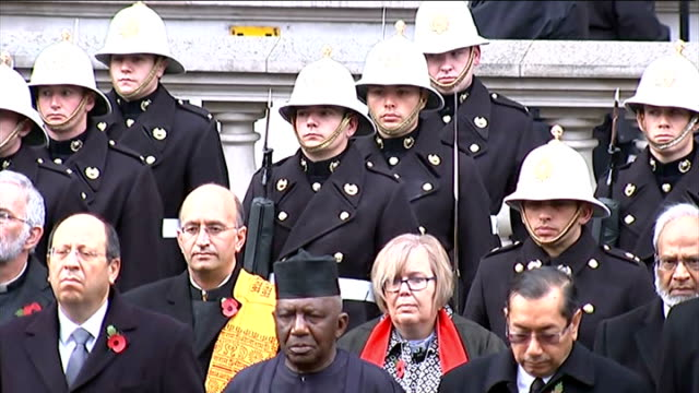 """remembrance day service at the cenotaph; crowd looking on as """"the last post"""" heard / commonwealth diplomats with members of the royal marines... - 英国海兵隊点の映像素材/bロール"""