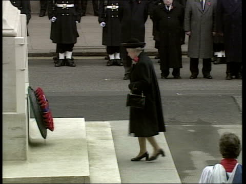 Remembrance day service BBC POOL Whitehall Royal Marine buglers play 'Last Post' SOT TMS SIDE Queen lays wreath CMS Queen bows CMS Queen Mother as...