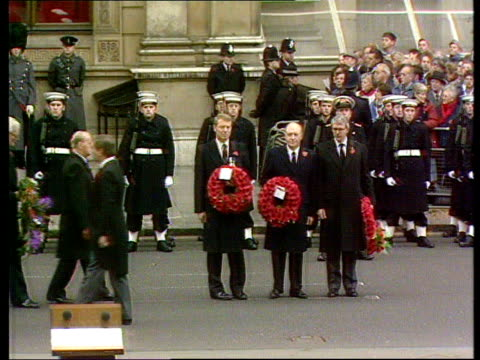 remembrance day service; england: london: whitehall tgv cenotaph with clergy and dignitaries standing as people carrying wreaths lms pm john major... - clergy stock videos & royalty-free footage