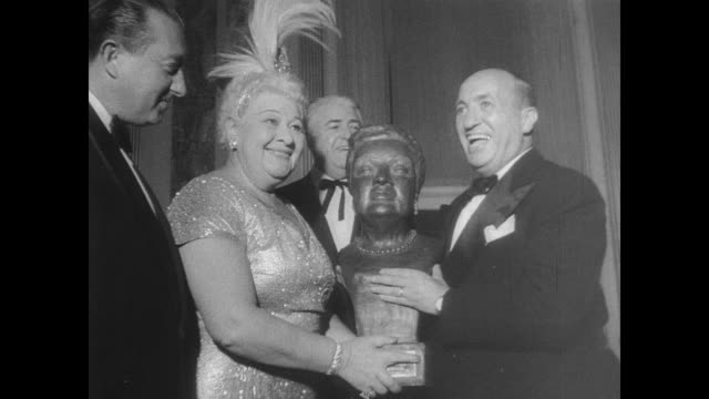 remembrance of singer and comedian sophie tucker on the occasion of her death / tucker smiling and fanning herself / packed room filled with... - tucker stock videos & royalty-free footage