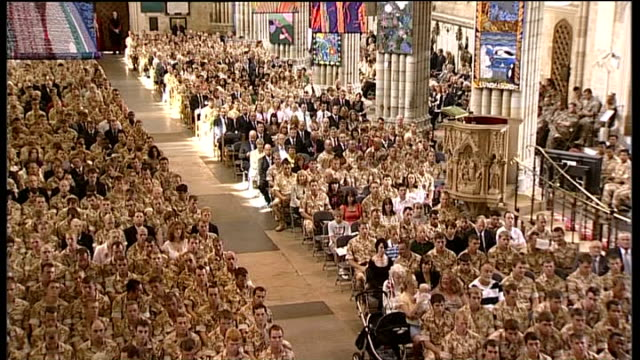 remembrance service in exeter * * church organ music heard during the following shots sot * * general view of british soldiers and families in... - music stand stock videos & royalty-free footage