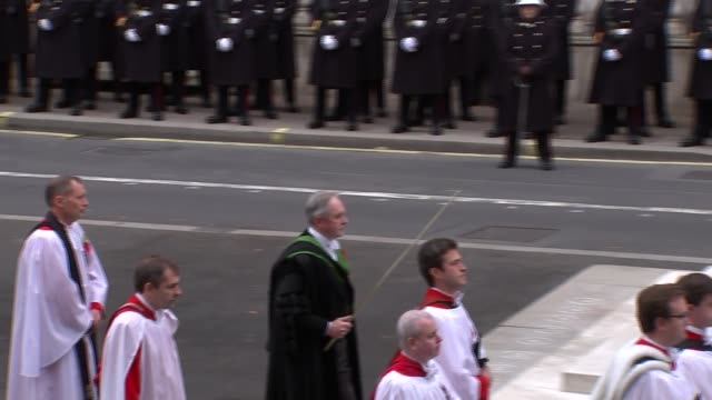 remembrance sunday at cenotaph england london whitehall ext procession moves around the cenotaph with clergy david cameron mp jeremy corbyn mp tim... - remembrance sunday stock videos & royalty-free footage