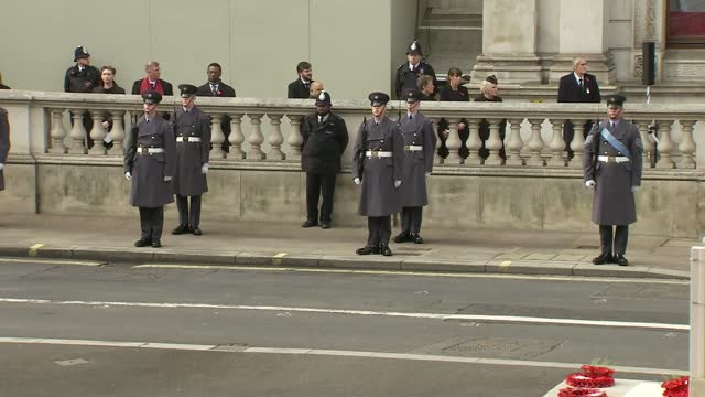 cenotaph remembrance service; england: london: whitehall: cenotaph: ext members of clergy leaving cenotaph at end of remembrance service, followed by... - former stock videos & royalty-free footage