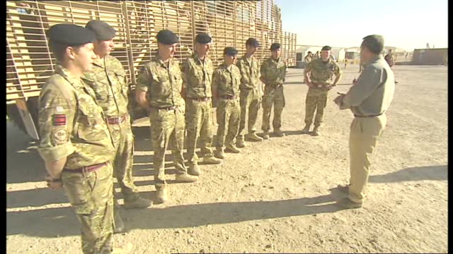 remembrance sunday commemorations: prince william meets nato troops at camp bastion; liam fox talking with group of international security assistance... - international security assistance force stock videos & royalty-free footage