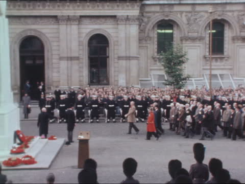 london: whitehall: ext gts ceremony during two minutes silence sof: last post gv ceremony queen elizabeth ii stands prince charles, prince of wales;... - remembrance sunday stock videos & royalty-free footage
