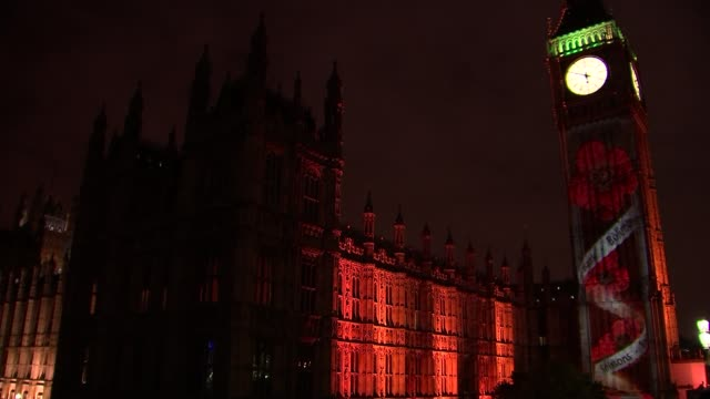 remembrance sunday events held london night illuminated houses of parliament and big ben clock tower with poppies projected onto it close shot popies... - remembrance sunday stock videos & royalty-free footage