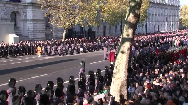 march past the cenotaph england london whitehall sot*** marching band / man in ceremonial uniform with golden staff / wide shot band playing /... - remembrance sunday stock videos & royalty-free footage