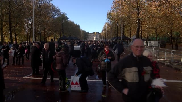 people's procession on the mall; england: london: the mall:extclose shots of crowd of people along mall / wide shot of people along mall / close... - remembrance sunday stock videos & royalty-free footage