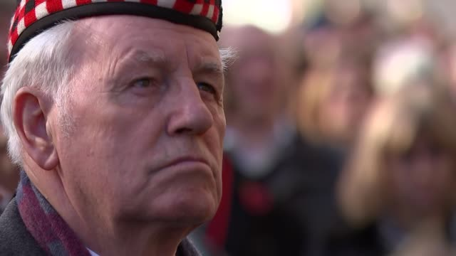 people's procession on the mall; england: london: the mall: ext **last post played sot** people observing two minute silence / general views of... - remembrance sunday stock videos & royalty-free footage