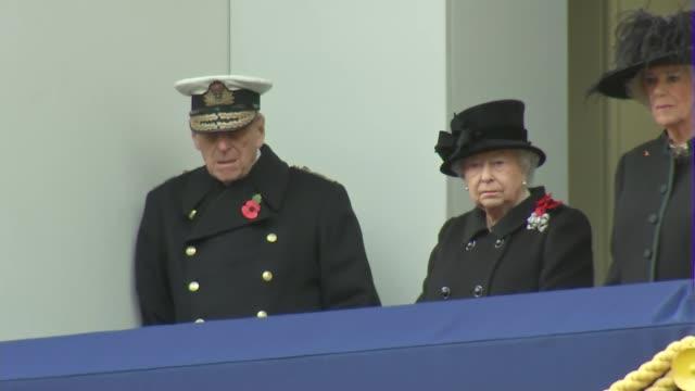 vídeos de stock, filmes e b-roll de queen and duke of edinburgh watch from balcony queen elizabeth ii standing on balcony with prince philip duke of edinburgh and camilla duchess of... - 2017