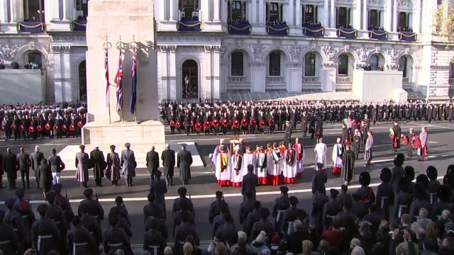 queen attends ceremony at whitehall; england: london: whitehall: ext buglers play last post during remembrance day ceremony at cenotaph wide shot of... - remembrance sunday stock videos & royalty-free footage