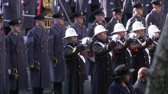 queen attends ceremony at whitehall; england: london: whitehall: ext buglers play last post during remembrance day ceremony at cenotaph queen... - remembrance sunday stock videos & royalty-free footage