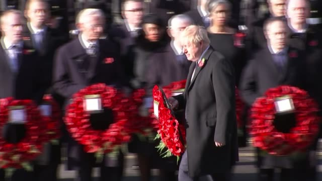 queen attends ceremony at whitehall; england: london: whitehall: ext boris johnson stands holding wreath alongside jeremy corbyn at remembrance day... - wreath stock videos & royalty-free footage