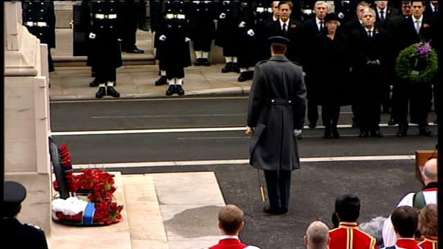 remembrance sunday: queen lays wreath at cenotaph; prince william lays wreath and salutes at cenotaph war memorial, followed by prince andrew / wide... - remembrance day stock videos & royalty-free footage