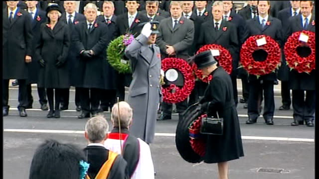 remembrance sunday: queen lays wreath at cenotaph; queen elizabeth ii standing as bugler plays sot clegg, cameron and brown with poppy wreaths /... - remembrance sunday stock videos & royalty-free footage