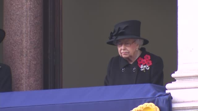 queen watches cenotaph service from balcony; england: london: westminster: whitehall: the cenotaph: queen elizabeth ii watching as last post heard... - remembrance sunday stock videos & royalty-free footage