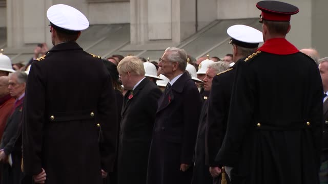 royals and politicians at cenotaph; long shot theresa may lays wreath / jeremy corbyn lays wreath / prince philip and queen elizabeth ii watching /... - remembrance sunday stock videos & royalty-free footage