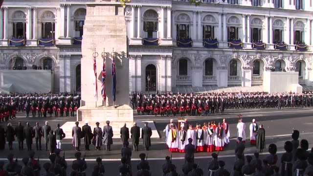 royals and politicians attend ceremony at whitehall england london westminster wide shot politicians at cenotaph / prince charles prince of wales... - remembrance sunday stock videos & royalty-free footage