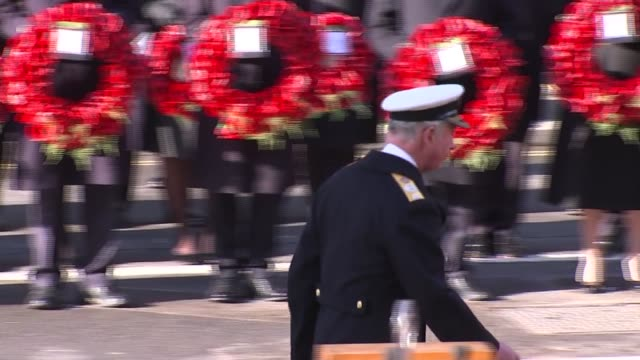 royals and politicians attend ceremony at whitehall; england: london: westminster: prince charles, prince of wales laying wreath at cenotaph and... - remembrance sunday stock videos & royalty-free footage