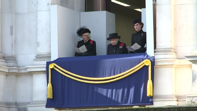 royals watching from balcony; england: london: westminster: ext queen elizabeth ii, camilla, duchess of cornwall, and catherine, duchess of cambridge... - remembrance sunday stock videos & royalty-free footage