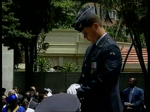 wreath laying at cenotaph:; e)13.00: u'lay pool south africa: durban: ext cms bugler playing 'last post' at multi-faith remembrance ceremony air... - remembrance sunday stock videos & royalty-free footage
