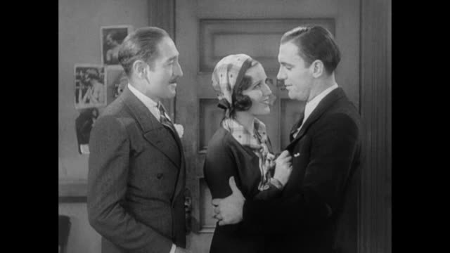1931 reminiscing between editor (adolph menjou) and reporter (pat o' brien) makes fiance (mary brian) determined for change - 1931 stock videos & royalty-free footage