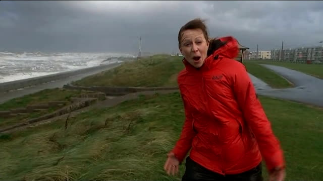 remnants of hurricane gonzalo hit uk; lancashire: blackpool: wide shot sea blowing over promenade with blackpool tower in background gvs waves... - extreme weather stock videos & royalty-free footage