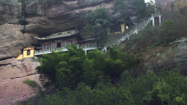 remote chinese temple or house - cliff dwelling stock videos & royalty-free footage