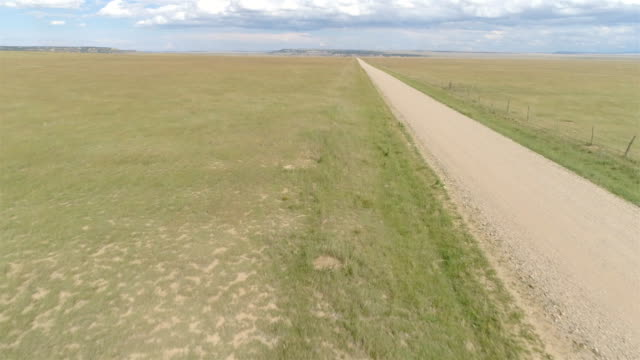 remote dirt road from colorado - great plains stock videos & royalty-free footage