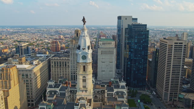 remote high-angle view of the philadelphia city hall. drone video with the ascending camera motion. - philadelphia pennsylvania stock videos & royalty-free footage
