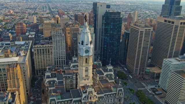 remote high-angle view of the philadelphia city hall. drone video with the panoramic wide-orbiting camera motion. - william penn stock videos & royalty-free footage