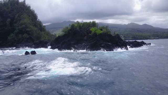 remote island coastline, aerial - land stock videos & royalty-free footage
