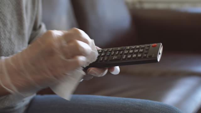 tv remote sanitizing - rubbing stock videos & royalty-free footage